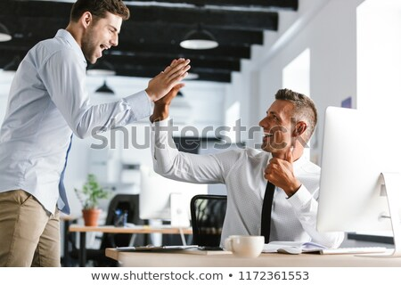 Photo of cheerful businessmen 30s in formal clothes giving high  Stock photo © deandrobot