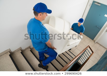 Two Male Movers Carrying Sofa Stock photo © AndreyPopov