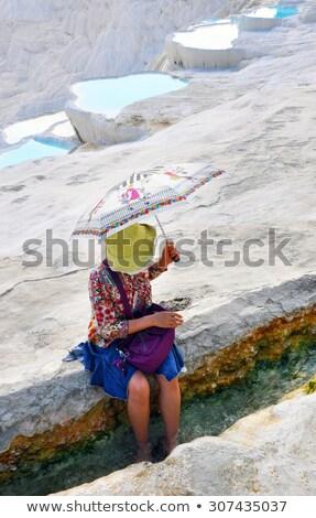 fiatal · nő · ül · kő · gyönyörű · hely · Tenerife - stock fotó © artfotodima