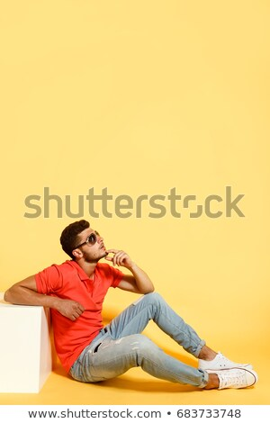 Portrait of a tired young casual man stock photo © deandrobot