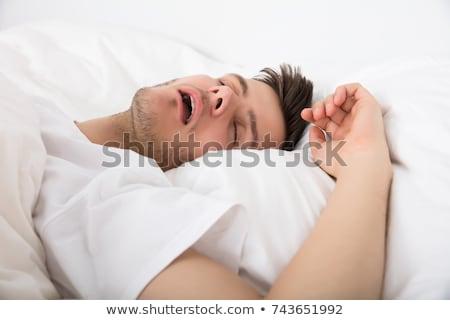 sonolento · homem · sessão · cama · jovem · casa - foto stock © andreypopov