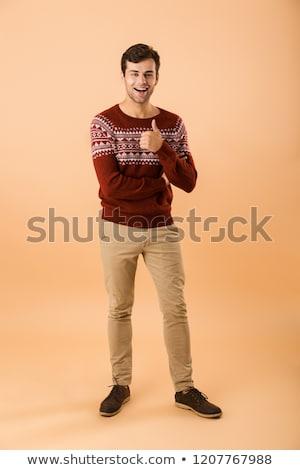 Immagine bella uomo 20s setola indossare Foto d'archivio © deandrobot