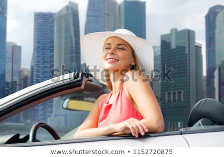woman in hat in convertible car over singapore Stock photo © dolgachov