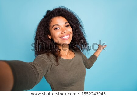 Photo of hipster african american woman with afro hairstyle show Stock photo © deandrobot