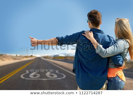 couple hitchhiking over us route 66 in america Stock photo © dolgachov