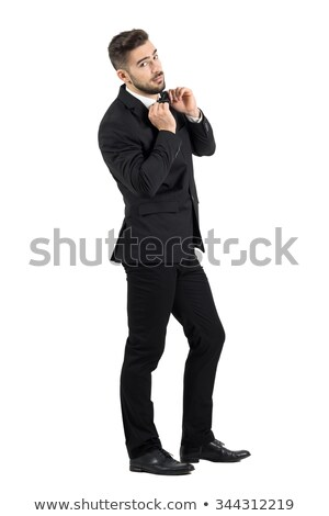 portrait of relaxed man in tuxedo looking up to side Stock photo © feedough