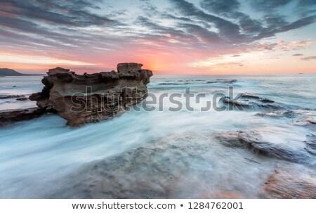 Kaya okyanus akım sabah gündoğumu Stok fotoğraf © lovleah