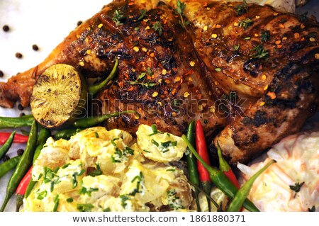 Homemade roasted spicy chicken with chilli and chive Stock photo © dash