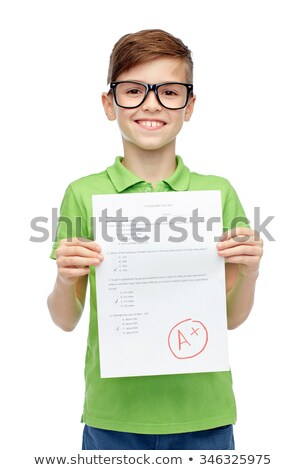 happy smiling boy holding school test with a grade Stock photo © dolgachov