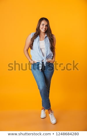 Smiling young overweight woman standing Stock photo © deandrobot