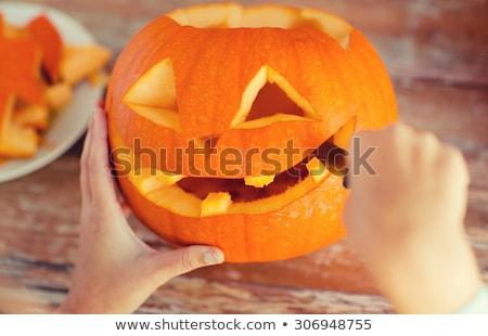 close up of woman carving halloween pumpkin Stock photo © dolgachov