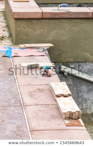 Trowels and New Tile At Pool Construction Site Stock photo © feverpitch