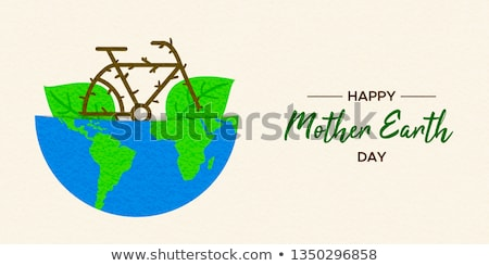 Earth Day concept of bike inside green planet Stock photo © cienpies