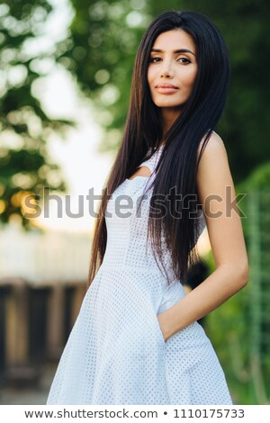 Foto morena pelo largo vestido blanco Foto stock © deandrobot