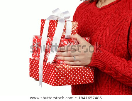 close up of woman in red sweater holding snowflake stock photo © dolgachov