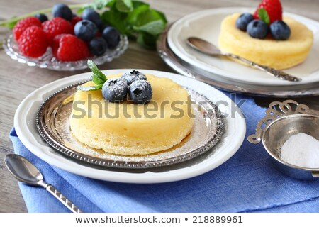 lemon delicious pudding cake served with berries stock photo © melnyk