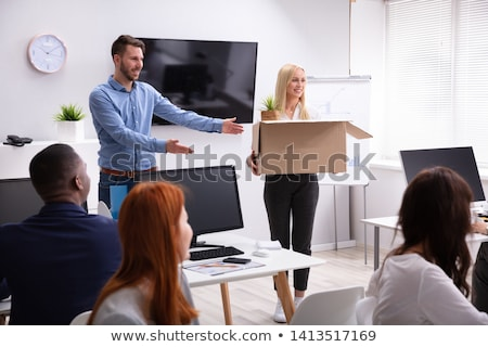 Manager Welcoming New Employee Introducing Her To Colleagues Stock photo © AndreyPopov