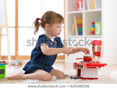 Girl Playing With Hot Cooking Pan Stock photo © AndreyPopov