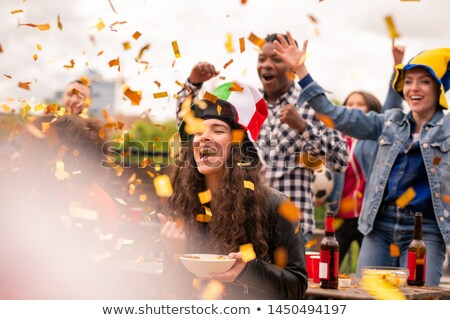 Joyful multicultural girls and guy expressing joy while shouting ecstatically Stock photo © pressmaster