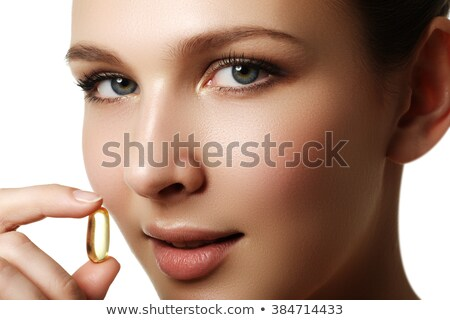 Portrait of woman with Omega 3 fish oil capsule, outdoors. Food Supplement. Portrait of young woman  Stock photo © serdechny