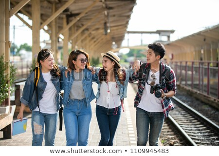 friends or travelers hiking with backpacks and map Stock photo © dolgachov