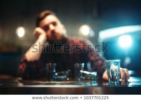 Jovem bêbado homem adormecido bar cerveja Foto stock © Lopolo