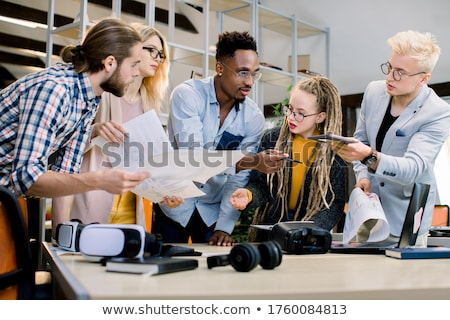 Stock photo: Young businessteam working with new startup project. discussing
