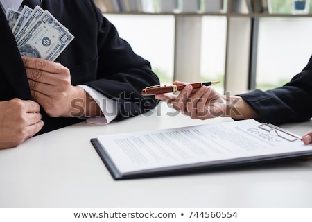 Bribery and corruption concept, bribe in the form of dollar bill Stock photo © Freedomz