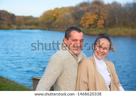 Young couple in love chilling by autumn lake. Happy man and woma Stock photo © dashapetrenko