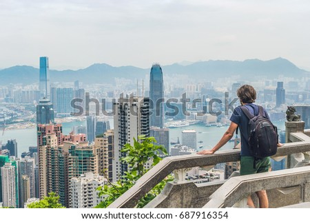 Young man traveler at the peak of Victoria against the backdrop of Hong Kong Stock photo © galitskaya