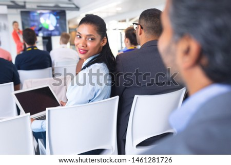 Rear view of diverse business people interacting with each other during seminar in office building Stock photo © wavebreak_media