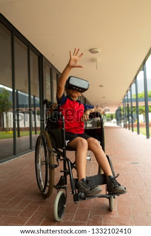 Front view of schoolboy using virtual reality headset at school in classroom Stock photo © wavebreak_media