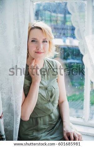 Brooding young blonde woman of young age posing on the river Bank. Photography in bright colors Stock photo © ElenaBatkova