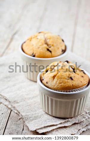 Two homemade fresh muffins on ceramic white bowls on linen napki Stock photo © marylooo