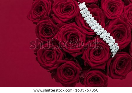 Luxury diamond bracelet and bouquet of red roses, jewelry love g Stock photo © Anneleven
