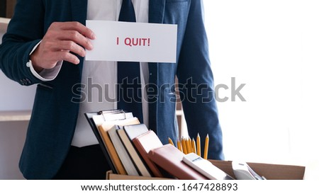 Businessman holding with I quit words card letter, resign employ Stock photo © snowing