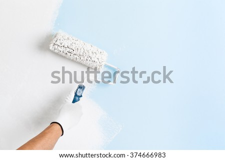 Man Working on Repairing Wall, Painting Roller Stock photo © robuart