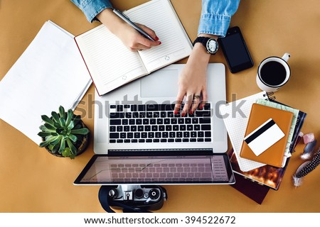 Woman holding laptop with financial concept Stock photo © ra2studio