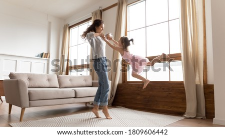Happy mother holding adorable child baby on the living room Stock photo © Lopolo