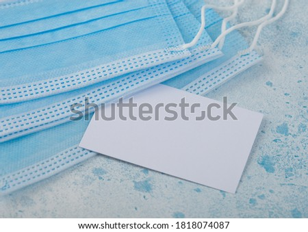 Medical face mask with white card on blue background. Best protection from coronavirus, germs,bacter Stock photo © DenisMArt