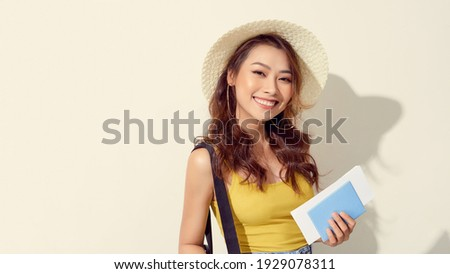 Image of optimistic girl wearing hat holding passport and travel Stock photo © deandrobot