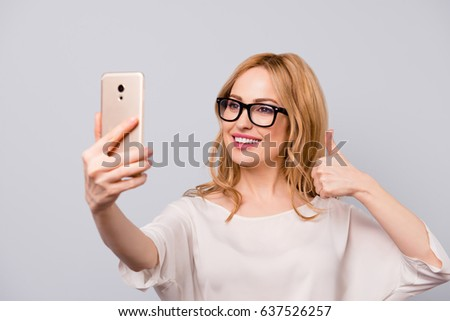 Woman in glasses take a selfie by camera. Stock photo © deandrobot