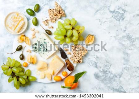 Cheese, grapes and olives antipasto Stock photo © karandaev