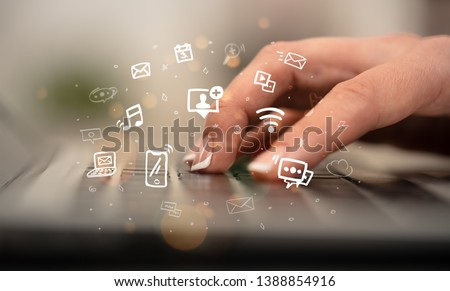 Woman typing on keyboard with application icons around Stock photo © ra2studio