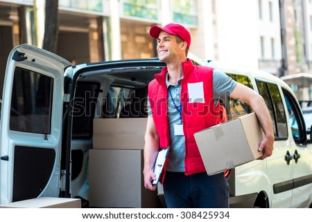 courier delivery man checking or holding cardboard parcel packag Stock photo © snowing