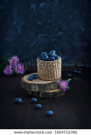 wild blueberry in autumn colors on wooden table Stock photo © dolgachov