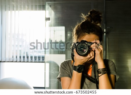 Asian woman photographer taking pictures with professional dslr camera on photography course in New  Stock photo © Maridav
