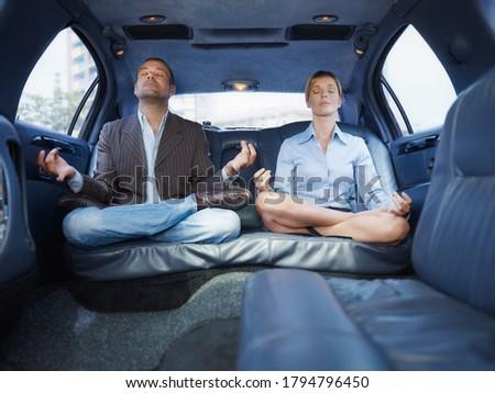 Empresário assistente ioga sessão limusine carro Foto stock © diego_cervo