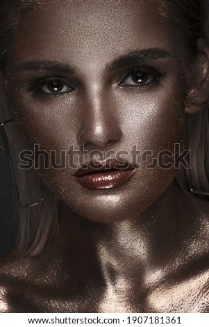 the sequin glittering creative make up girl, her face is raised  Stock photo © carlodapino