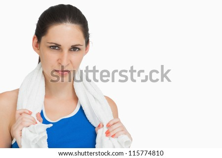 Serious brunette in sportswear with a towel against white background Stock photo © wavebreak_media